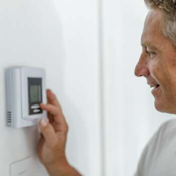 Home heating thermostat